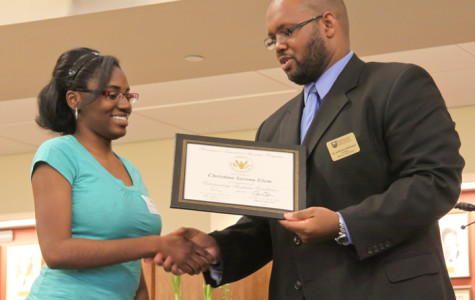 Senior Christina Elem accepts her Presidential Education Award from Principal Anthony Robinson.