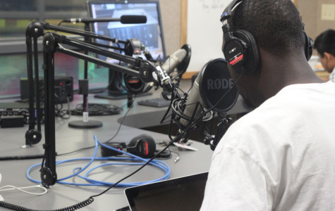Junior Johnnell Ball records programming for KRHS 90.1 FM, Ritenour High School's radio station