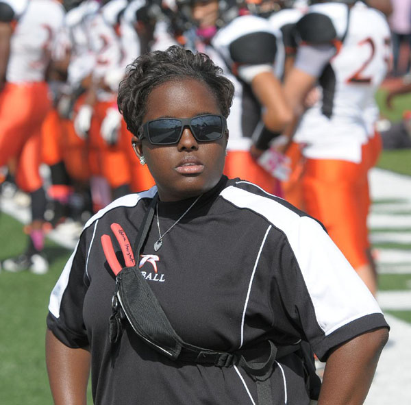 Athletic trainer Petra Knight watches the field and keeps an eye on the players during a game againtst Pattonville.