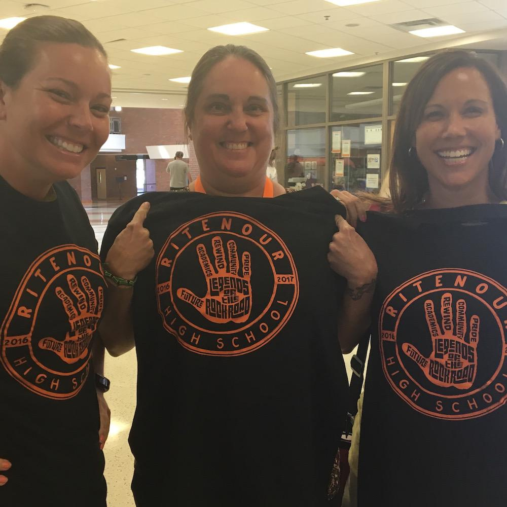 Ritenour teachers celebrate getting new staff shirts, compliments of Jostens.