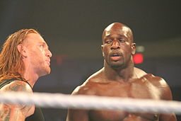 Slater Gator (Heath Slater and Titus O'Neil) at a SmackDown/Main Event taping on September 16, 2014.