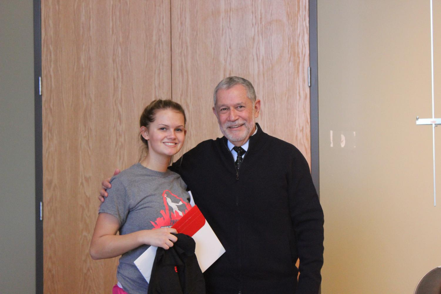 Dr. Carlos Vargas-Aburto, president of SEMO, poses with senior Cassidy Schatz.  Dr. Vargas presented Schatz with an admission letter to SEMO when he spoke to students on Dec. 1.