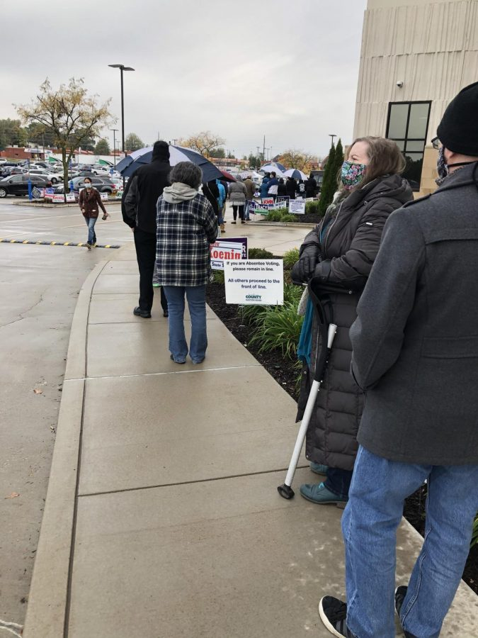 Voters wait in line at the County Government Center in Northwest Plaza for absentee voting. An expected increase in voting is happening due to the presence of COVID-19, so absentee voting has expanded in this presidential election cycle.