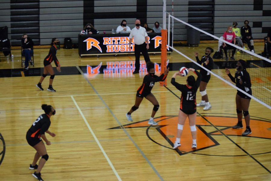 The girls volleyball team competes in a game in Costilow Fieldhouse during the 2021 season.  As recently as 1981, the girls only played in the small gym while the boys hosted all of their games in the fieldhouse.
