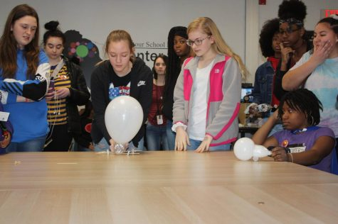 """Allie Hansen, Hailey Drake, Lailah Lotz, Rene Nelson, Mercedes Cendejas, and Marie Thompson work together during the """"Girls in Engineering"""" day in 2019.  While COVID has prevented this event from happening in the last two years, it is an event hosted by the PLTW program to allow for more people to have access to the field of engineering."""
